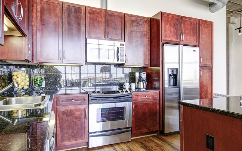 open, roomy kitchen with luxurious countertops and cabinets