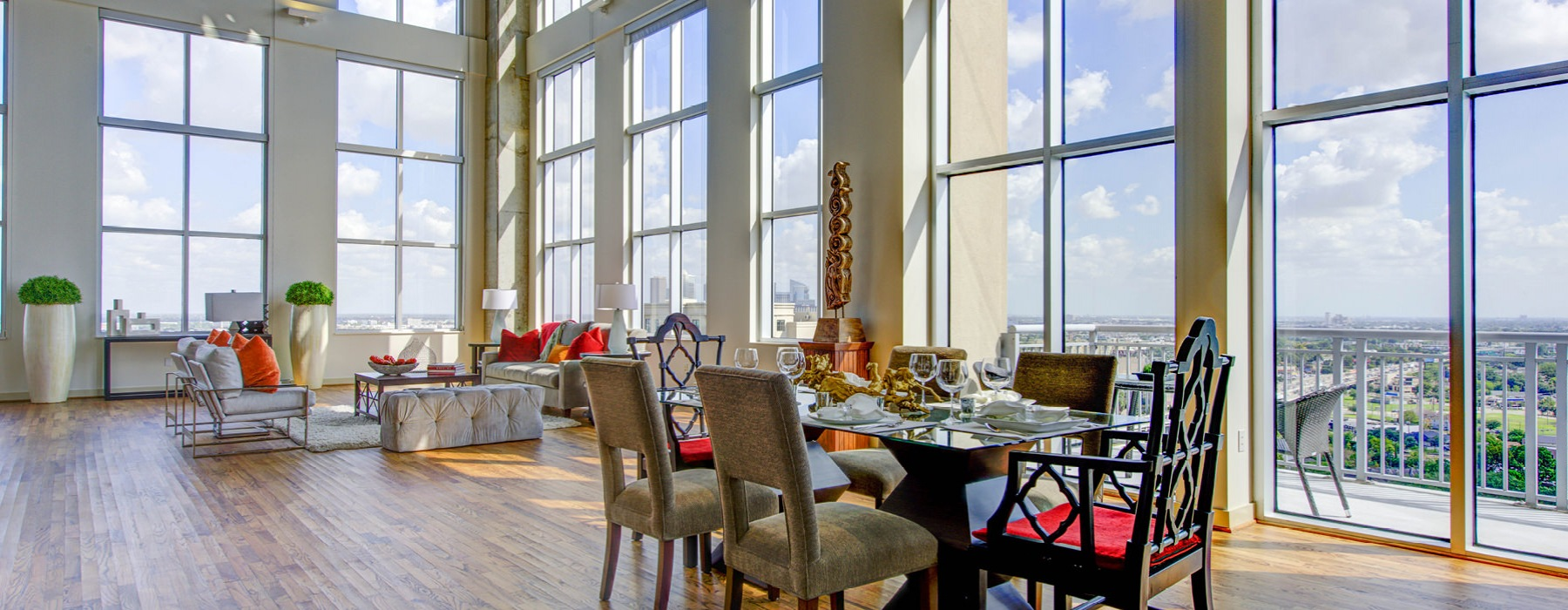 humongous living room and dining area with floor-to-ceiling windows